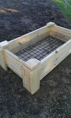 DIY slow feeder for horses, made with treated 2x6s and a metal grate