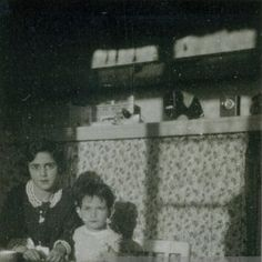Sisters Margot Frank & Anne Frank (right), photographed by their father, Otto Frank, at their kitchen table in 1931