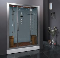 Learn how to make a contemporary bathroom that wows. | Steam Showers Inc.'s shower and Barnlight Originals' light