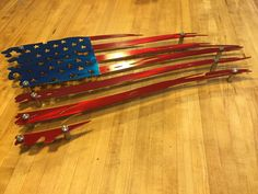 "3 dimensional Weathered Old Glory / Painted 2 footer, 3 footer and 4 footer (ships in 4 pieces...some assembly required) Includes 10 stainless steel 2"" stand"