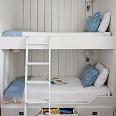 In this bunk room on Galveston Bay, the designers went nautical, with shiplap walls, sconces for easy nighttime reading, and smart storage underneath the lowest bunk.