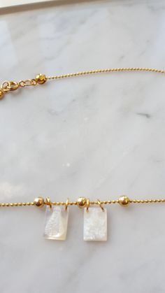 This stunning necklace is a result of decenarios cool trying to give a modern spin to the traditional scapular necklace. This statement necklace is made with a gold-filled ball and chain and findings accentuated by two scapular mother of pearl pendants of Virgin Mary and Jesus . Religious  style necklaces are the it accessory for 2016, you will look amazing wearing this gorgeous piece.          Size:17.5Inches  Pendant size: .5 inch     | Shop this product here…