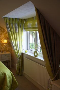Dormer window with show curtains and matching Roman blind