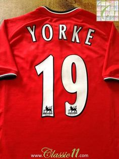 Official Umbro Manchester United home football shirt from the 2000/01 season. Complete with Yorke #19 in offcial Lextra Premier League lettering.