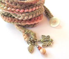 Sweet and versatile crochet wrap bracelet or necklace in subtle variegated shades of rose, pink and olive made of soft, hand painted, cotton yarn featuring glass bead and metal charms. This soft, lovely wrap bracelet measures approximately 67 and wraps about 9 - 10 times on a 6 - 7 wrist but can be wrapped more or less times to fit any size and about 3 times around the neck as a lovely soft necklace. This soft and subtle colored wrap can be worn many ways and will make a fun addition to your…