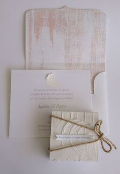 wedding in Santorini | minimal modern total white handcrafted wedding invitations | unique wedding favor box wrapped in handcrafted case with brush stroke | designed by www.bemyguest.com.gr Let your guests feel the Aegean breeze the moment they receive your invitations!