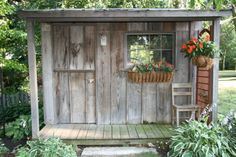 Potting shed from recycled materials. The siding came from a 100 yr. old barn. The roof was scrap barn roofing. The windows salvaged from curbside.
