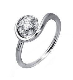 El solitario JOAQUIM VERDÚ 8 es un diseño exclusivo, realizado por el creador de Moda Joaquim Verdú. Este prestigioso diseñador español nos trae un solitario de diamantes elegante y de hermoso diseño, fabricado con Oro de Primera Ley que incorpora diamantes de la más alta calidad. Es una joya ideal como anillo de compromiso, o como un regalo para una persona especial.