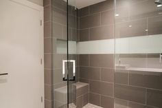 SEAMLESS GLASS SHOWER IN MASTER BATHROOM