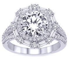 This elaborate double halo with baguettes on the outside (but surrounding a pear shaped diamond instead).