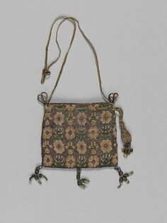 Purse | British | early 17th century | Canvas worked with silk and metal thread; Gobelin, tent, knots and plaited braid stitches, silk and metal thread cord and tassels | Metropolitan Museum of Art | Accession #: 29.23.17