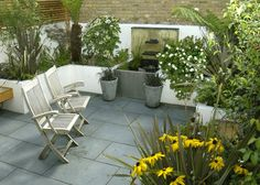 Pretty family garden with raised pond 2.jpg