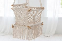 Gorgeous macrame swing for lucky littles. Would be a beautiful decor accent. #estella #kids #decor