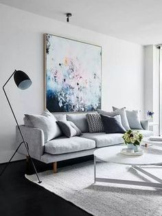 Grey sofa and blue artwork