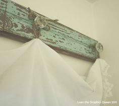 Rustic window treatment with old wood & glass knobs