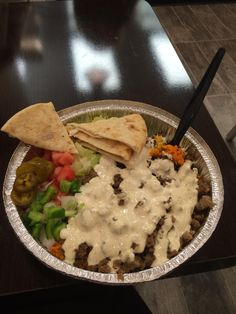 The Halal Guys - One of New York's most popular food trucks has finally opened up a storefront in Gold Coast.