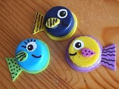 these would be cute fish magnets......recycle bottle caps!