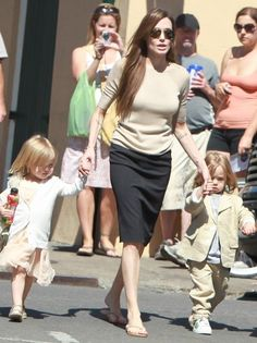 Wow pencil skirt and flip flops. Who knew? (angelina jolie style, black and white