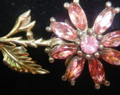 A floral pin with Chanel signature,Rhode Island,1940s,Pink stones