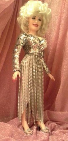1cd7d621ce1e Jonathan Guffey s Original Ooak Dolly Parton doll wears a replica of the  rhinestone gown worn in the closing scene of the movie.