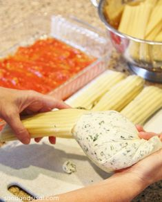 The easy way to stuff manicotti shells. Click through for printable recipe.