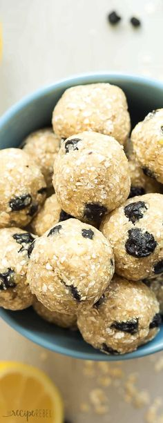 These Lemon Blueberry Energy Bites breakfast are an easy, no bake snack that's perfect for back to school or summer road trips! Just a few ingredients and they're gluten free with paleo and vegan options. Press them into a pan for granola bars! No Bake Snacks, Easy Snacks, Real Food Recipes, Snack Recipes, Yummy Food, Dessert Recipes, Tasty, Road Trip Food, Road Trips
