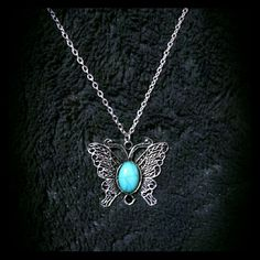 """Antiqued Boho Butterfly Necklace Beautiful new, retail sale, 19"""" silver tone, turquoise center, butterfly pendant and chain.  Gorgeous addition to any outfit. I've gotten tons of compliments on my own! Jewelry Necklaces"""