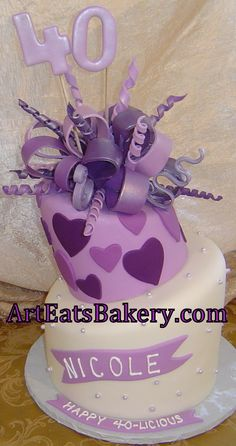 Two tier purple and white hearts and pearls custom 40th birthday cake design with sugar bow and 40 topper photo