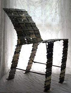 This chair was created by Etsy seller Neva Starr out of 122 old metal door hinges, welded together #upcycling