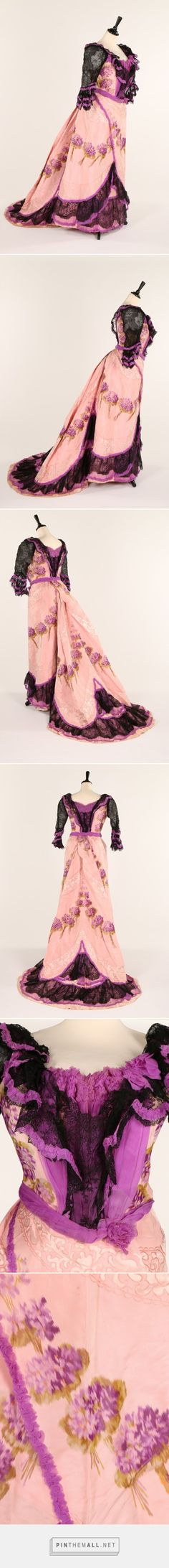 Circa 1900 pink and purple chiné taffeta evening gown woven with sprays of violets and edged in purple and black chiffon and lace.