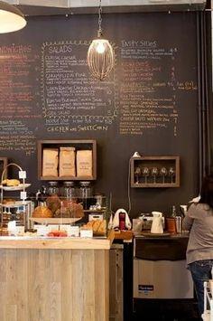Rustic café interior with a chalk board menu.