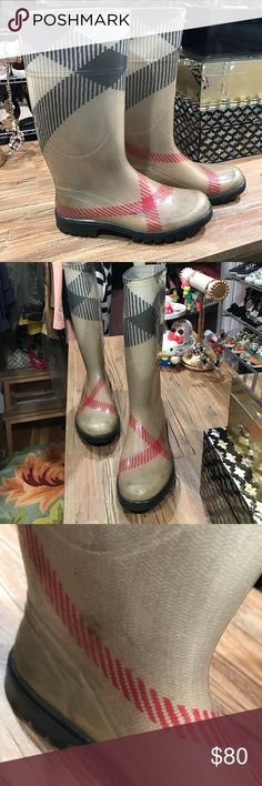 Burberry Checked Rain Boots Lovely Burberry Rainboots! Slight scratches, but still has plenty of great style! Very protective and a necessity for those ugly rainy days! European size 36 (US size 6) Burberry Shoes Winter & Rain Boots