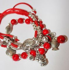 Chinese red string bracelets.