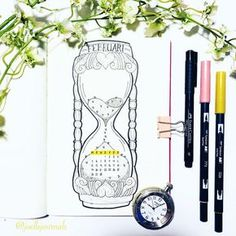 Bullet journal monthly cover page, February cover page, hourglass drawing. | @joellejournals