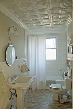 #decorating Ceiling, walls and flooring give this bathroom such great texture!!!  Love the mirror!