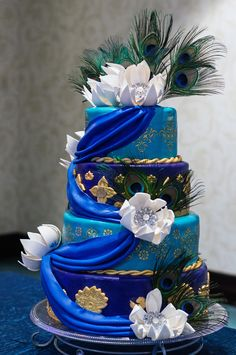 Real Wedding Wednesday ~ What do Stilt Walkers, Peacock Feathers & An AMAZING Cake Have in Common? http://www.bitchlessbride.com/blog/2013/5/22/real-wedding-wednesday-what-do-stilt-walkers-peacock-feather.html
