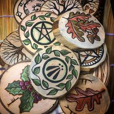 A variety of wood rounds that are burned or painted. These are just about ready to hang! Celtic Christmas, Noel Christmas, Christmas Crafts, Christmas Ornaments, Pagan Christmas Tree, Xmas, Yule Decorations, Christmas Decorations, Yule Traditions