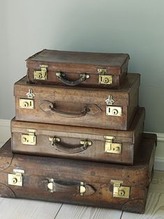 Stacked vintage suitcases in a dining room corner..