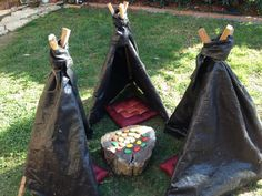 """A 'Meeting Place' at Puzzles Family Day Care... little individual tents placed in a circle with a central point in the middle promotes conversation. The tents are just 3 tomato stakes tied with rope & covered with black weed mesh ("""",)"""