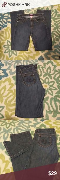 """Lilly Pulitzer Medium-Dark Wash Denim Jeans Dresses, skirts, and jeans...oh my! Oh my is right when it comes to Lilly! All of her pieces are just stunning including her denim jeans line. These jeans are from the """"Main Line Fit"""" collection and feature Lilly's signature """"L"""" on each back pocket. A slimming medium-dark wash makes these jeans perfect to go from day to night! Inseam measures approx. 33"""". Size 8. Excellent Pre-loved Condition. Fast NEXT Day Shipping. Thank you for shopping my…"""