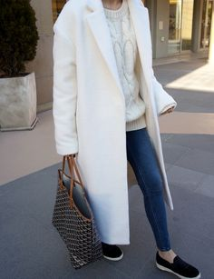 Clean, classic and cic. Cream coat, Slip ons and #Goyard tote.