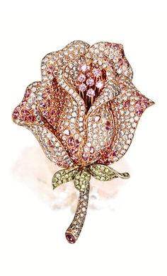 PINK DIAMOND AND COLOURED DIAMOND 'ROSE' BROOCH Modelled as a rose, set with brilliant- and calibré-cut pink diamonds together weighing approximately 7.70 carats, highlighted by stem and leaves set with brilliant-cut yellowish-green and brown diamonds, mounted in 18 karat white and pink gold.