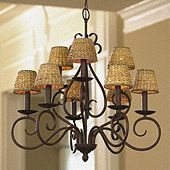 Not too big. Not too small. Not too expensive. Our Talia Chandelier is just right for a breakfast area, dining room or entry when you want a simple, comfortable look. Handcrafted of steel with nine scrolled candle arms ready for your choice of shade. Ceiling cover and 6' hanging chain included. Antique bronze finish. Shades pictured are not included.Shades sold separately.