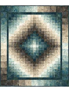 """Create a gradient illusion of motion!   This quilt is easily pieced together to reveal a finished project full of beauty and motion. Use 1 each of the Slate and Blue Planet Charm Packs, 1 each of the Slate and Blue Planet Jelly Rolls, and the Dark Blue Planet 1-yard cut (all below) to complete this quilt. Finished size is 50"""" x 60""""."""