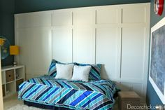 """Boy's Room Makeover by Decor Chick    Project Info:  Paint Color – Behr """"Underwater""""  $40 Paneled Wall  Chalkboard Wall  Spray painted yellow lampshades  Chevron Bedding – Wal-Mart  Curtains – Curtainworks  Wall Map – CQ Wall Decals  Shaggy Rug – Garden Ridge  Small accent rugs – Big Lots"""