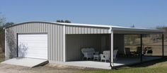 Texas steel building with lean/to roof over concrete.