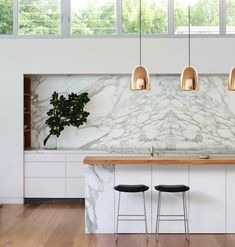 Modern kitchen: marble backsplash, wood countertop and copper pendants for island. Home Interior, Kitchen Interior, Kitchen Decor, Interior Decorating, Interior Design, Marble Interior, Kitchen Shelves, Kitchen Layout, Kitchen Styling