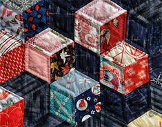 Floating cubes quilt, hand stitched with Japanese fabrics.  Chambre des Coulleurs (France).