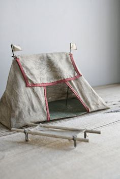 Charming antique toy army tent & cots. #playeveryday