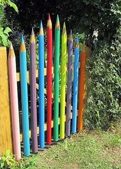 colored pencil logs gate - would be great for an entry into the children's garden area. #kids #gardening